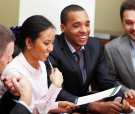 Multi ethnic business team at a meeting. Interacting. Focus on w