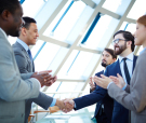 Group of business people congratulating their colleagues with st