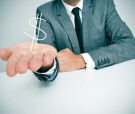 a businessman sitting in a desk showing a drawn dollar sign in h