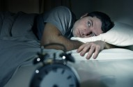 Man In Bed With Eyes Opened Suffering Insomnia And Sleep Disorde