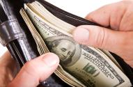 bigstock-Dollars-In-Wallet-2755284
