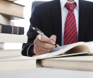 Businessman Writing On A Book