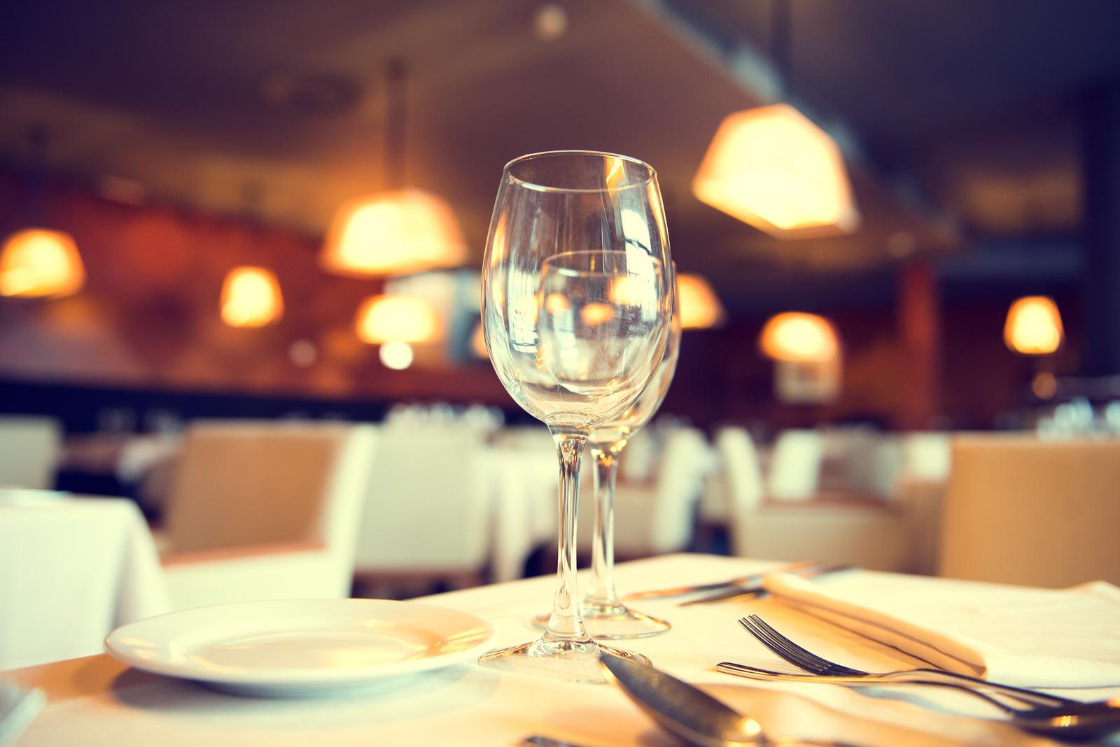 Served dinner table in a restaurant. Restaurant interior. Cozy r