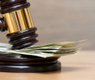 Law gavel on a stack of American money