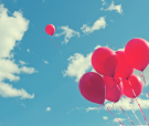 Bunch Of Red Ballons On A Blue Sky