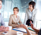 Female business team of four working together to achieve good re