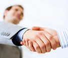 Close up image of business handshake at meeting. Partnership con