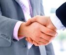 handshake isolated on blue background